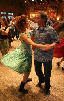 Annie Fain and Robert Forsyth dancing in the Community Room