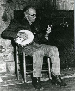 J Roy Stalcup plays his banjo in Keith House.
