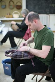 David Rakoff weaves a basket at the Folk School