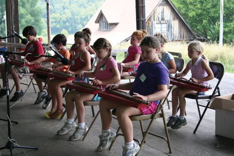 Little/Middle Folk School dulcimer class performs on the Festival Barn Stage.