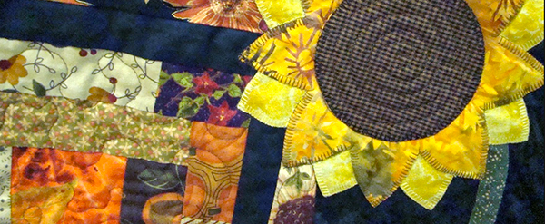 """Detail of """"It's Fall, Y'all: Fun Scrappy Autumn Quilt"""" by Audrey Hiers"""