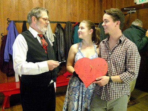 Nick and VIctoria hold the tangible Big Red Heart of the Folk School as Jan hands them the Sharpie of Destiny. Nic & Vic were a 2012 addition to the Big Red Heart.
