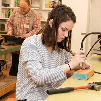 "Hannah works on a jewelry project in Tom & Kay Patterson's class, ""Mechanical Connections."""