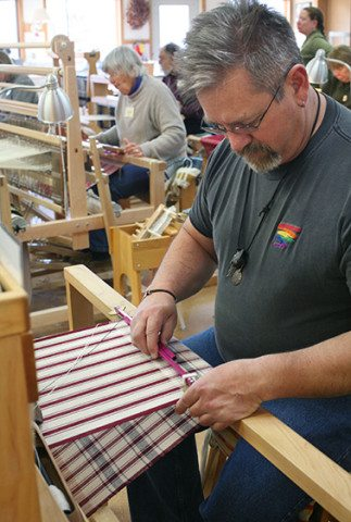 A student at the loom