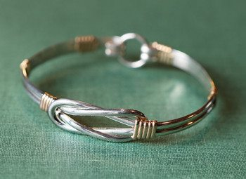 """Come bid at the Blacksmith & Fine Craft Auction on this gorgeous sterling silver & gold filled """"love knot"""" bracelet by Judy Peppers."""