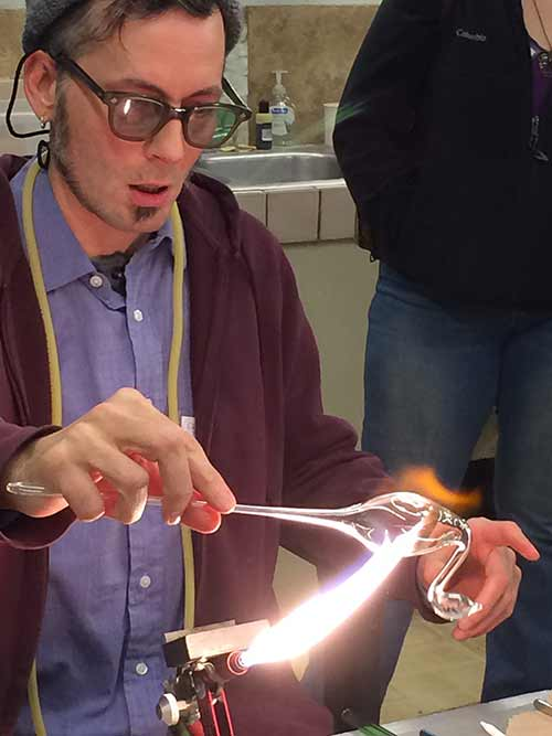Tony Prince shapes a glass blown swan with the heat of the torch.