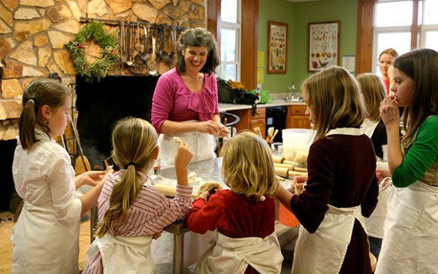 Children make cookies for the Holiday Kids Party