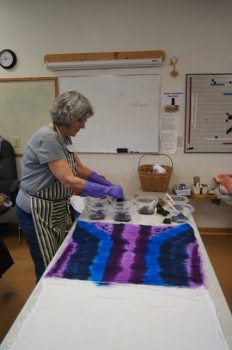 Helen is getting started putting color on her warp.