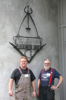 Matt Jenkins (left), standing next to Clay Spencer in front of the new sign. Matt designed the Clay Spencer Sign.