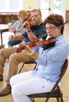 Students practicing fiddle