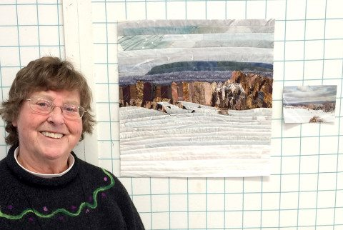 "Mary next to her ""Quilted Landscape"""