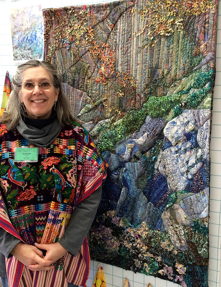 Instructor Karen Tunnell in front of one of her Quilted Landscapes.