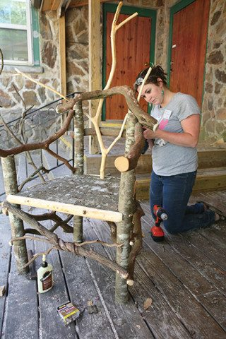 Using the organic shapes found in branches, a student constructs a rustic chair on the Woodworking porch
