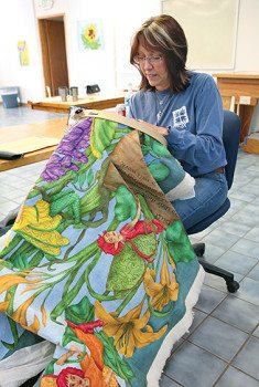 Cathy Wiggins works on one of her quilts.