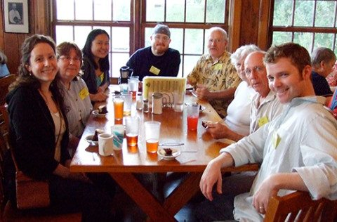 The Crampton Family in the Dining Hall L-R: Rachel Reinhart, Nancy Crampton, Valerie Castelo, Matthew Crampton, Dan Crampton, two JCCFS students, Paul Reinhart.