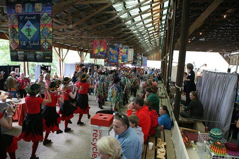 The Brasstown Morris Dancers parade to the Fall Festival stage.