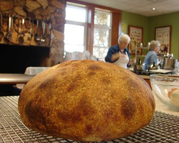 This sourdough loaf rose for two nights instead of the usual one night. The class agreed that it had an even better flavor. Blisters develop on dough in the refrigerator, and this loaf developed large blisters that burned in the oven.