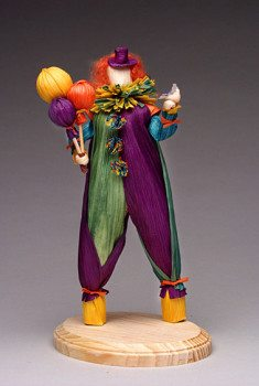 Corn husk clown with bird and balloons by Anne Freels