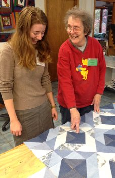 Audrey teaches Sara about quilt design in the Folk School Quilting Studio.