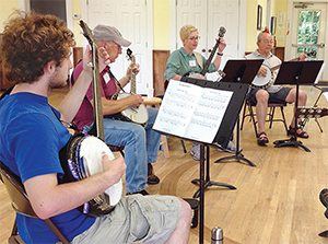 Try old-time, two-finger picking style banjo during our Long Weekend