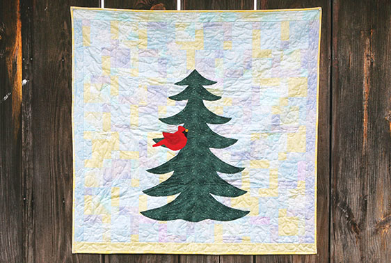 Holiday quilt by Audrey Hiers