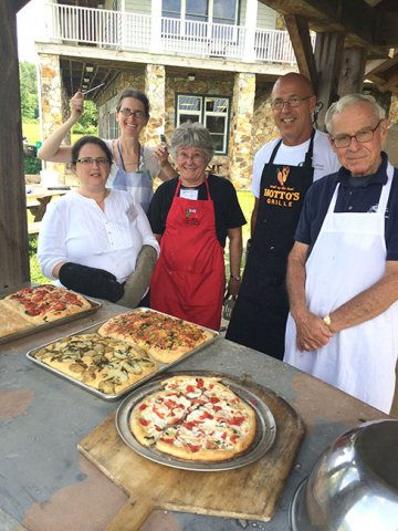 Delicious wood fired focaccia and pizza baked in Emily Buehler's class.