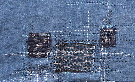 Detail of a denim shirt embellished with Boro techniques by Karen Swing.
