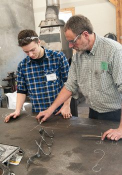 Aaron Niederman plans his Blacksmithing project with instructor Ron Nichols.