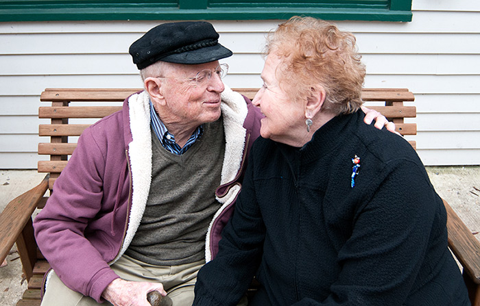 Fred and Martha enjoys a happy moment on the bench outside Keith House.
