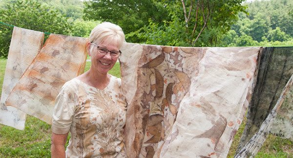 Kathy Hays displays her eco print creations outside the Wet Room.