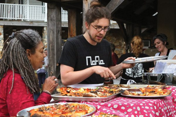 Arianne and Forrest consider their pizza pie options.
