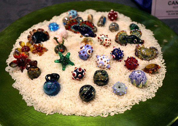 A variety of beads made by Terry's students on display at Show and Tell
