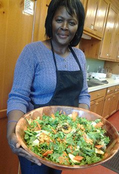 A student holds a delicious salad created in