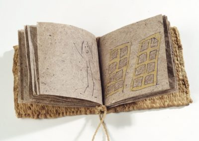 The story of a book (2011). Pen and pencil comic on handmade slippery elm paper, slippery elm-dyed hanji yarn corded and woven, kon'nyaku-covered covers. 3.25 x 3.25 x 0.5″. MIA.