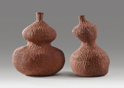 Paired gourds (2014). Persimmon dye on hanji. 7″ high, 6″ wide; 6.5″ high, 3.5″ base diameter. Private collection.